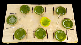 Green cutlery set on table ready for food to be served isolated on black. Royalty Free Stock Photo