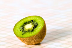 Green cutout fruit kiwi on the table Royalty Free Stock Image