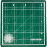 Green cutting mat with letter Royalty Free Stock Images