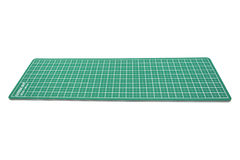Green cutting mat of office isolated on white background Royalty Free Stock Photography