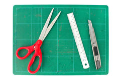 Green cutting mats with scissors ruler and cuter on white backgr. Ound Stock Photos