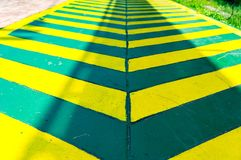 Green lane with yellow line. Green Cycle lane with yellow line royalty free stock photo