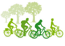 Green cyclist silhouettes Royalty Free Stock Image