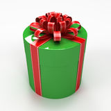 Green cylindrical gift box with red ribbon Royalty Free Stock Photos