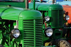 Green czechoslovak historical agricultural diesel tractors from 1950s displayed on expo. Royalty Free Stock Images