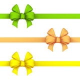 Green, daffodil and yellow gift bows Royalty Free Stock Photography