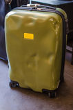 Green damaged luggage dented Royalty Free Stock Photo