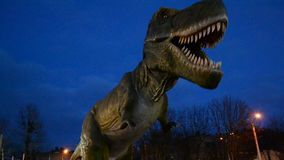 Green and dangerous dinosaur in park stock footage