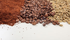 Green and dark coffee beans and ground coffee Royalty Free Stock Photo