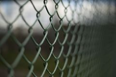 Green dark mesh fence closeup background. Green dark mesh fence closeup urban background Stock Photography