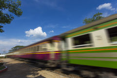 A green dark moving train. royalty free stock photo
