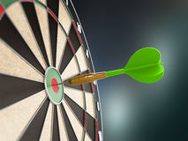 Green dart at the center of the target Royalty Free Stock Image