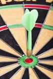 Green Dart hitting the dartboard Royalty Free Stock Photo