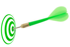 Green dart hitting target center . Stock Photos
