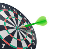 Green dart hitting target center Royalty Free Stock Photo