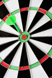 Green dart punctured in the center. Of the target royalty free stock photography
