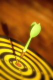 Green dart on target Stock Images