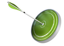 Green dart or target and arrow isolated. Arrow hitting the center of a dart. the target is green and the image is isolated over white background Stock Photography