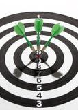 Green darts on target Royalty Free Stock Photo