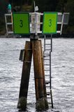 Day Beacon on Seattle`s Lake Union. Green Day beacon marks the way into and out of harbor Royalty Free Stock Photo