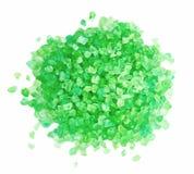 Green dead sea salt heap. Isolated on white stock image