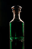 Green Decanter. A decanter filled with green creme de menthe liquer Royalty Free Stock Photo