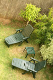 Green Deckchairs in a Garden. Green Deckchairs in a Well Maintained Garden Royalty Free Stock Photography