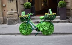 Green decorated bicycle. A beautiful green decorated bicycle for the entrance of a hotel somewhere in Italy royalty free stock image