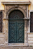Green decorated  carved door in Venice Ghetto. Stock Image