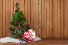 Green Decorated Christmas Tree and Gift on Wooden Background. Royalty Free Stock Images