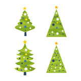 Green decorated Christmas tree with a yellow star Royalty Free Stock Photography