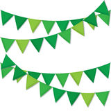 Green decorative flags streamers to celebrate St. Patrick`s Day decorations. Royalty Free Stock Photos