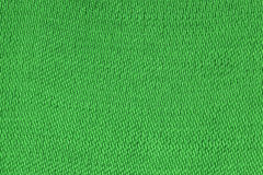 Green decorative polyester fabric texture background, close up stock image