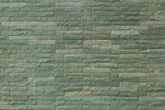 Green decorative stone wall texture background Stock Images