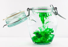 Green Deep Diffusion. An antique jar full of liquid with green colour stock images