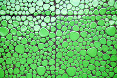 Green defferent shape mosaic tiles Royalty Free Stock Photo
