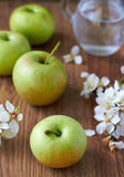Green delicious apple. On wooden surface Stock Images