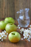 Green delicious apple. On wooden surface Stock Image
