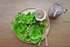Green delicious salad and a glass of chocolate milk Stock Photo