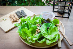 Green delicious salad, soy snacks, and modern lantern Royalty Free Stock Photography
