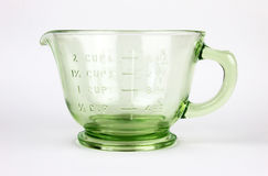 Green Depression Glass Measuring Cup. Green Depression Glass 2-cup capacity measuring cup on isolated white background royalty free stock images