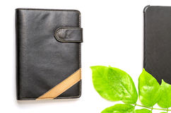 Green desktop diary pen tablet foliage background Royalty Free Stock Photos