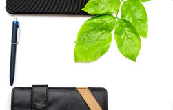 Green desktop diary pen tablet foliage background Royalty Free Stock Images
