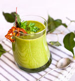 Green detox smoothie close up. Green smoothie decorated with parsley and dry fruit close up in restaurant royalty free stock photography