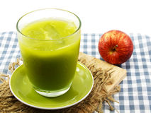 Green devil avocado smoothie selective focus and red apple Stock Photos