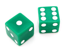 Green dice. Pair of green dice on a white surface royalty free stock image