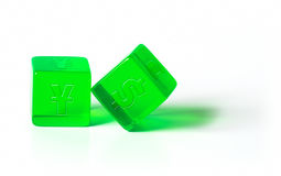 Dice with currency symbols. Green dice with Dollar, Yuan, Yen and Euro symbols on a white background Stock Photos