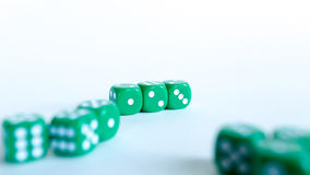 Green dices. Close-up on a white background stock photography
