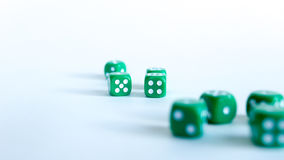 Green dices. Close-up on a white background royalty free stock photo