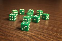 Green dices on wooden table. Dices on wooden table - game of chances Stock Photos